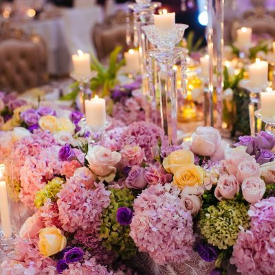 table settings with flowers and glass candles KL